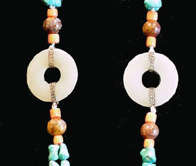 Turquoise, Coral and Agate Necklace with Carved Double Jade Prayer Wheel - Closeup View of Jade Bi