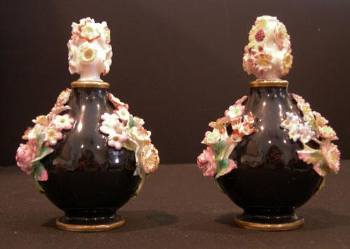 Pr. 19th c. Jacob Petit Black-Ground Flower-Encrusted Scent Bottles and Stoppers